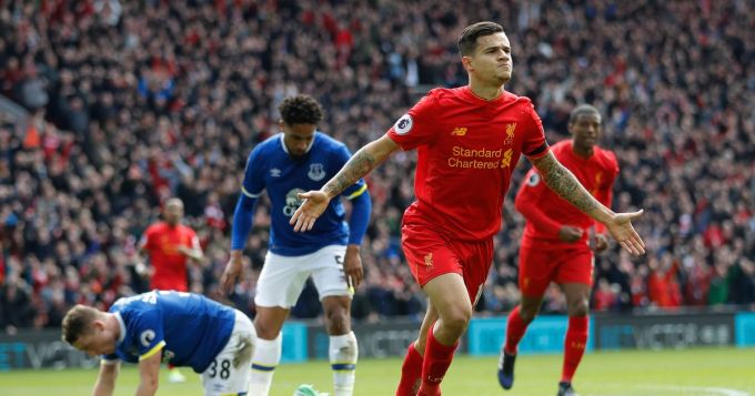 Liverpools-Philippe-Coutinho-celebrates-scoring-their-second-goal-as-Evertons-Matthew-Pennington
